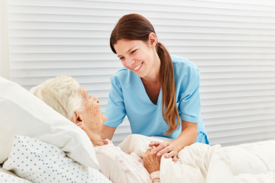 caregiver caring for elder woman