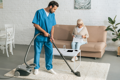 caregiver cleaning carpet with vacuum cleaner